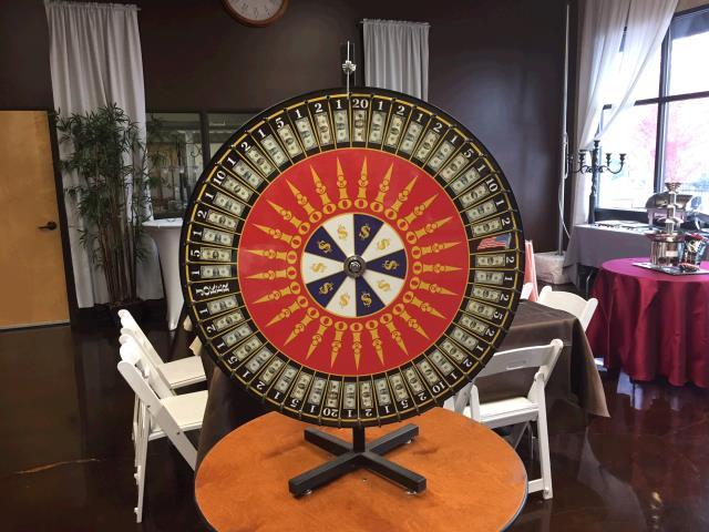Where to find WHEEL-OF-CHANCE, 36  MONEY W TABLE STAND in Portland